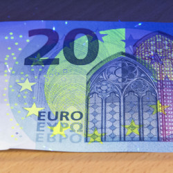 Ultraviolet light shows the security features of the new 20 euro banknote set to be introduced across the 19-country eurozone on Wednesday.