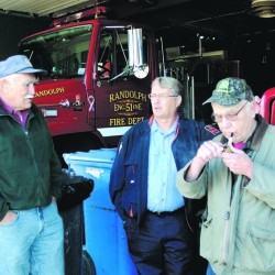 "Lewis ""Duddy"" Brown, left, Ron Cunningham and Andy Cooper chat in 2007 in the bay of the Randolph Fire station. Brown died Monday night after being hit by a car outside his home in Pittston."