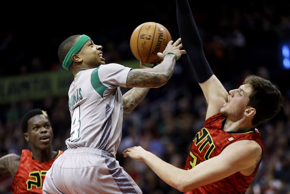 The Celtics' Isaiah Thomas goes up against Hawks defender Mike Muscala in the first quarter of Boston's loss Tuesday night in Atlanta. Thomas finished the game with 14 points.