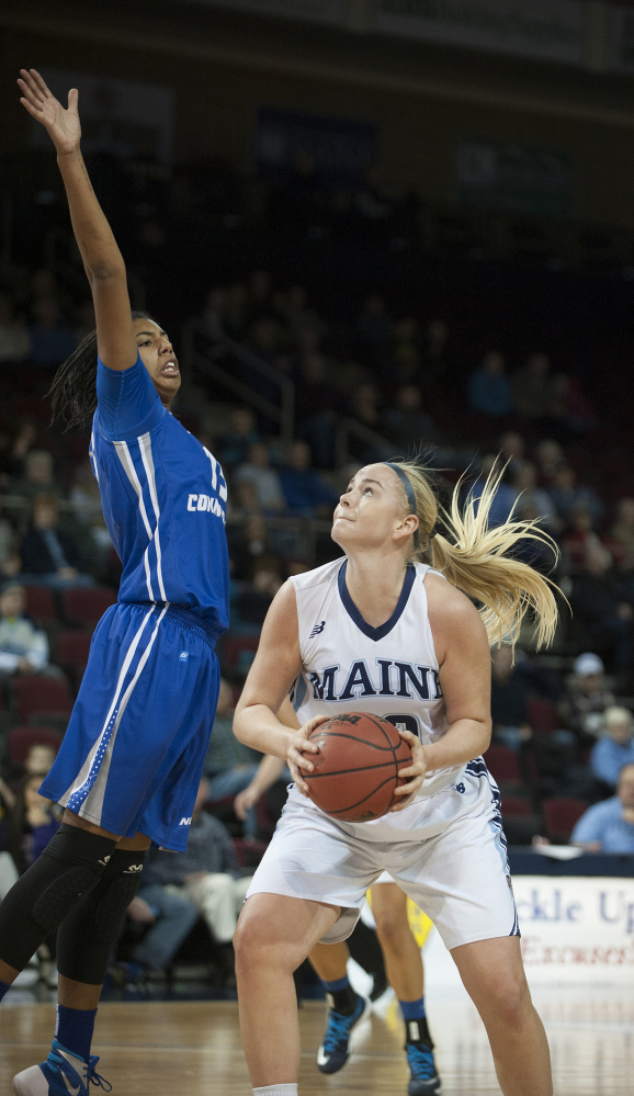 Mikaela Gustafsson of the University of Maine waits for Giocelis Reynoso of Central Connecticut State to return to the ground before shooting Wednesday. Maine won, 62-42.