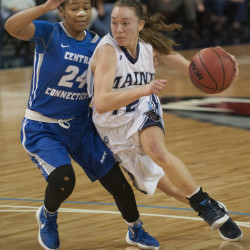 Maine's Sigi Koizar drives to the basket against Central Connecticut State University's Aleah Epps on Wednesday at the Cross Insurance Center. UMaine won, 62-42.