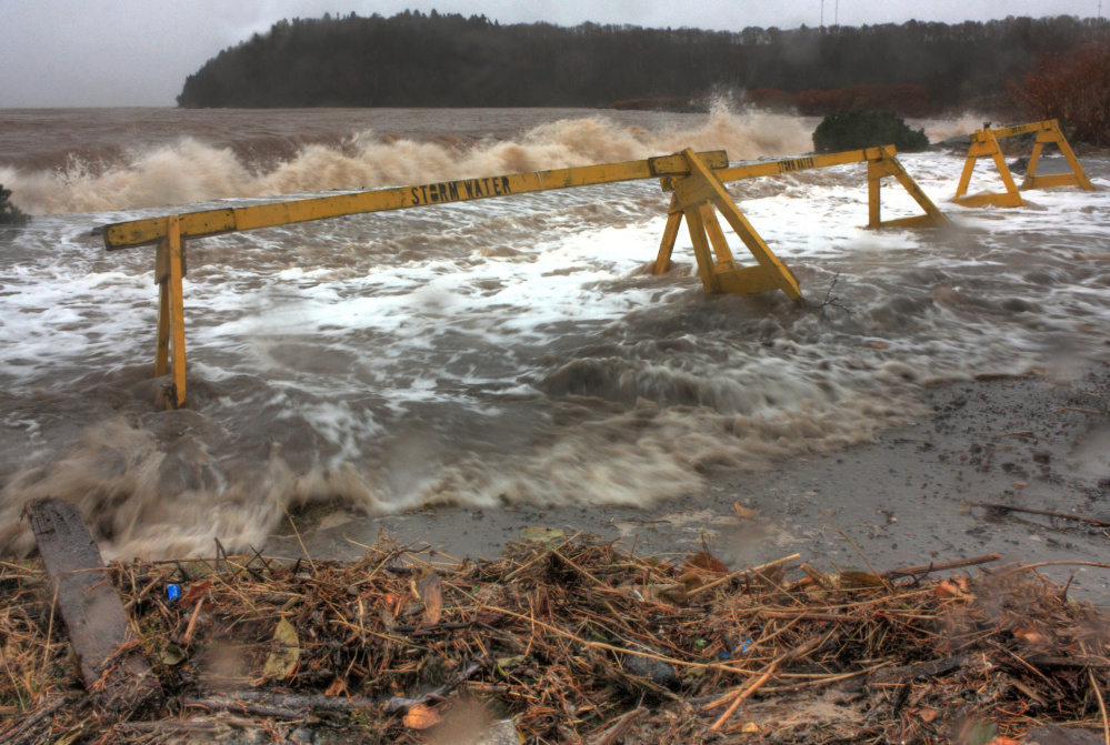 In a winning image from the 2015 Gulf of Maine King Tides Photo Contest, a high tide crosses into the parking lot at McLaren's Beach in Saint John, New Brunswick, Canada.