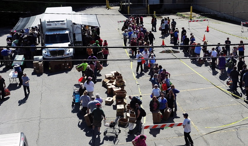 The line snakes through the parking lot in Augusta where a Good Shepherd Food Mobile event took place in 2014. Good Shepherd distributed a record amount of food last year – and estimated that it could have given away much more and still not met demand.