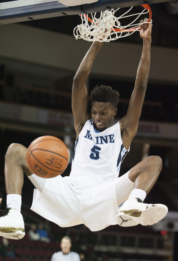 UMaine's Devine Eke goes up for a dunk in Wednesday's win against Longwood at the Cross Insurance Center in Bangor.