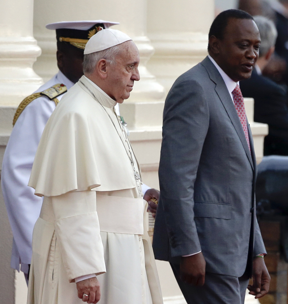 Pope Francis is greeted by Kenya's President Uhuru Kenyatta, right, at Nairobi's State House on Wednesday.