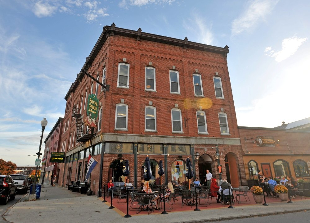 Charlie Giguere's newly renovated downtown Waterville building at 2 Silver St. in Waterville is seen in October 2014. The project was honored by Maine Preservation last week, one of 16 in the state the organization recognized. Giguere has turned upper floors of his business, Silver Street Tavern, into offices and apartments.