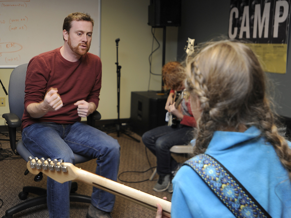 Just as donations to nonprofits were about to drop off during the recession, Jeff Shaw started a music school in Portland – and has managed to make it work. Here, he instructs guitar player Greta Holmes, 10, of Portland.