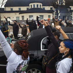 Family members of Jamar Clark show support for Black Lives Matter demonstrators as Clark's funeral procession passes the Minneapolis 4th Precinct police station on Wednesday. Clark was fatally shot Nov. 15 in a scuffle with police.