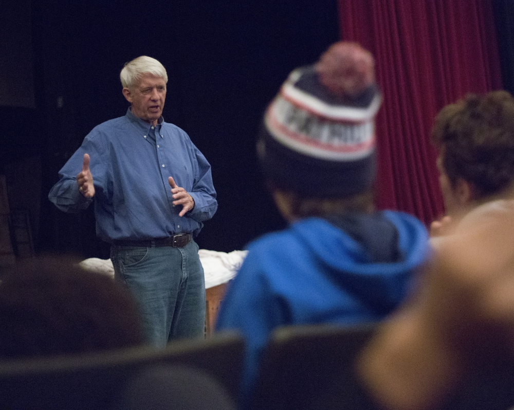 Dick Capp, who played in a legendary Thanksgiving Day game for Deering in 1959 and then went on to play in a Super Bowl, speaks to Deering High students Wednesday.
