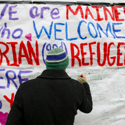 This sign on Congress Street drew together in a memorable encounter several people concerned about refugees' plight, a reader writes.