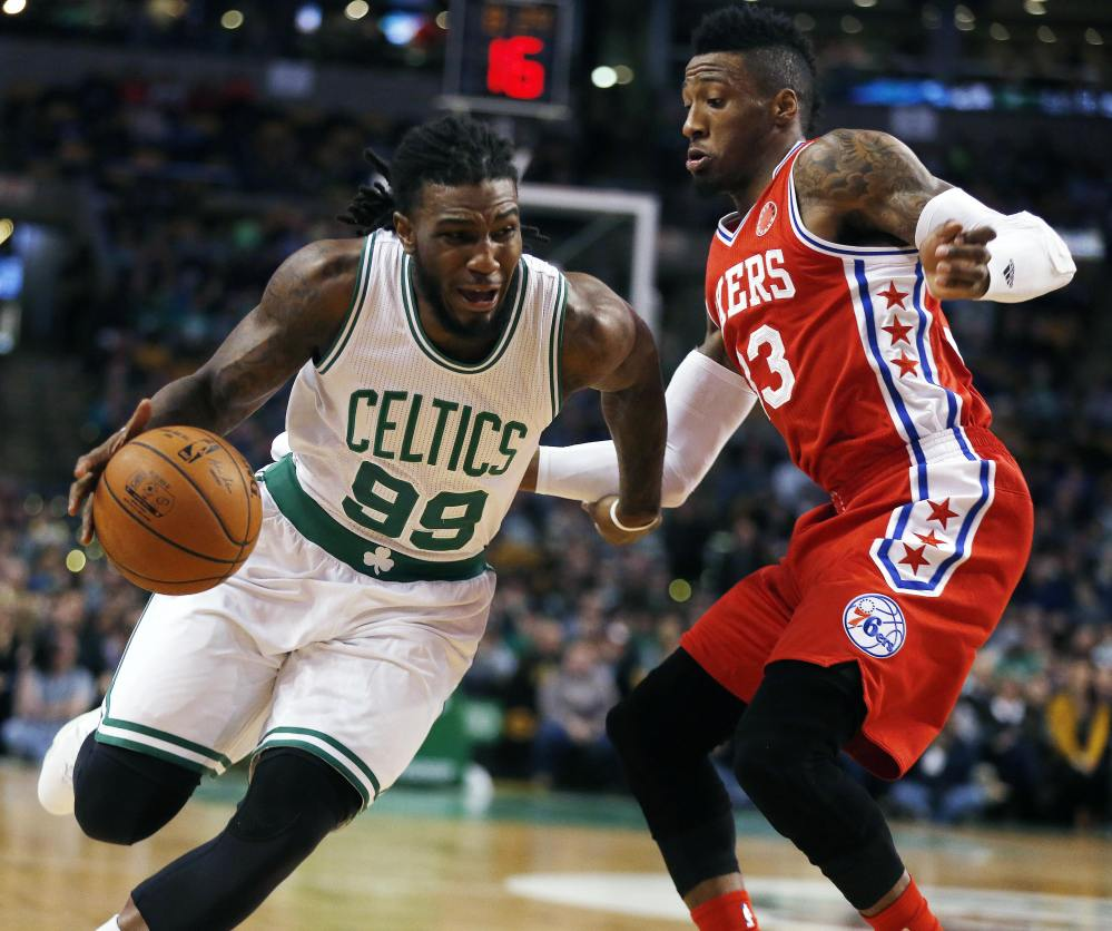The Celtics' Jae Crowder drives past the 76ers' Robert Covington in the first quarter of Wednesday's night's game in Boston. Crowder hit the game-winning 3-pointer for the Celtics in the final minute.