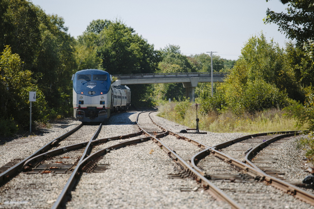 An Amtrak Downeaster train on the tracks near the Brunswick train station in 2014.