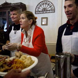 Volunteers, from left, John Monahan, Michael Quint, Marlies Heitmann, Phil Allard and Perry St. Louis serve a Thanksgiving meal at the Portland Club on Thursday during Wayside Food Programs' annual community dinner.