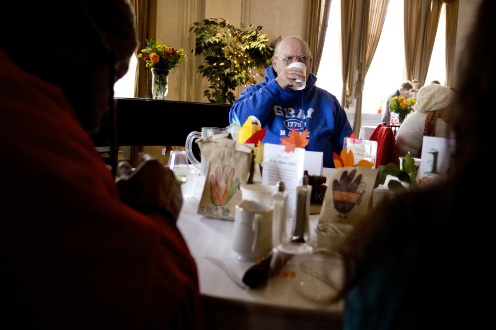 Bud Buzzell of Portland takes a sip of coffee after finishing his Thanksgiving meal at Wayside Food Programs' community dinner at the Portland Club.