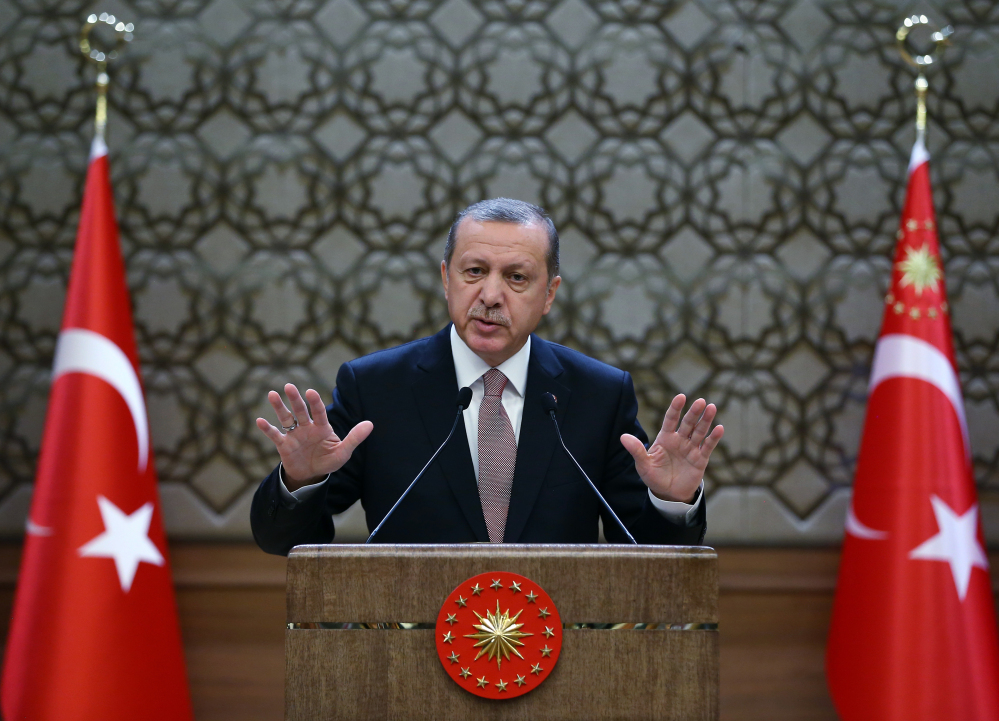 Turkish President Recep Tayyip Erdogan addresses local administrators at his palace in Ankara on Thursday. Turkey has released audio recordings of what it says are the Turkish military's repeated warnings to the pilot of the Russian plane before it was shot down at the border with Syria.
