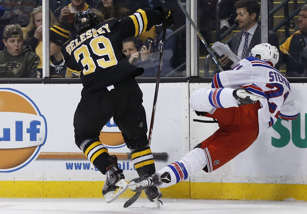 Matt Beleskey sends the Rangers' Derek Stepan into the boards in the second period of Friday's game.