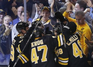 The Bruins' Torey Krug (47), Colin Miller (48) and teammates celebrate the go-ahead goal by David Krejci, back right, late in the third period of Friday's afternoon game against the New York Rangers in Boston. The Bruins won, 4-3.