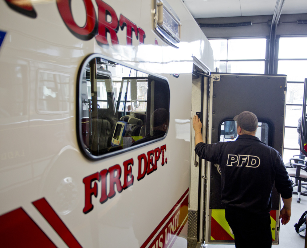 "Keith Corey, a firefighter and advanced EMT with the Portland Fire Department, shuts off a light on the ambulance at Munjoy Station on Friday after doing inventory checks. The ambulance was taken out of service Wednesday and Thursday because of overtime concerns, and will operate on a ""day-to-day"" basis, according to the acting fire chief."