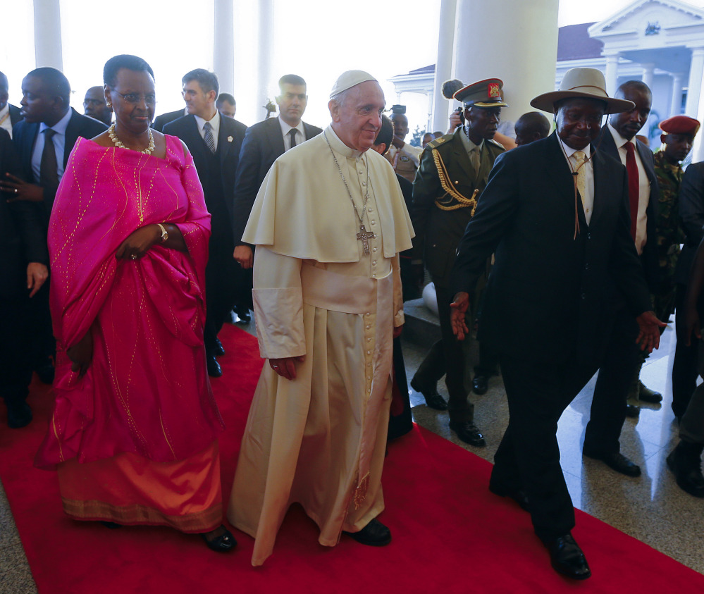 Pope Francis meets with Uganda's President Yoweri Kaguta Museveni, right, and his wife, Janet, in Entebbe, Uganda, on Friday.