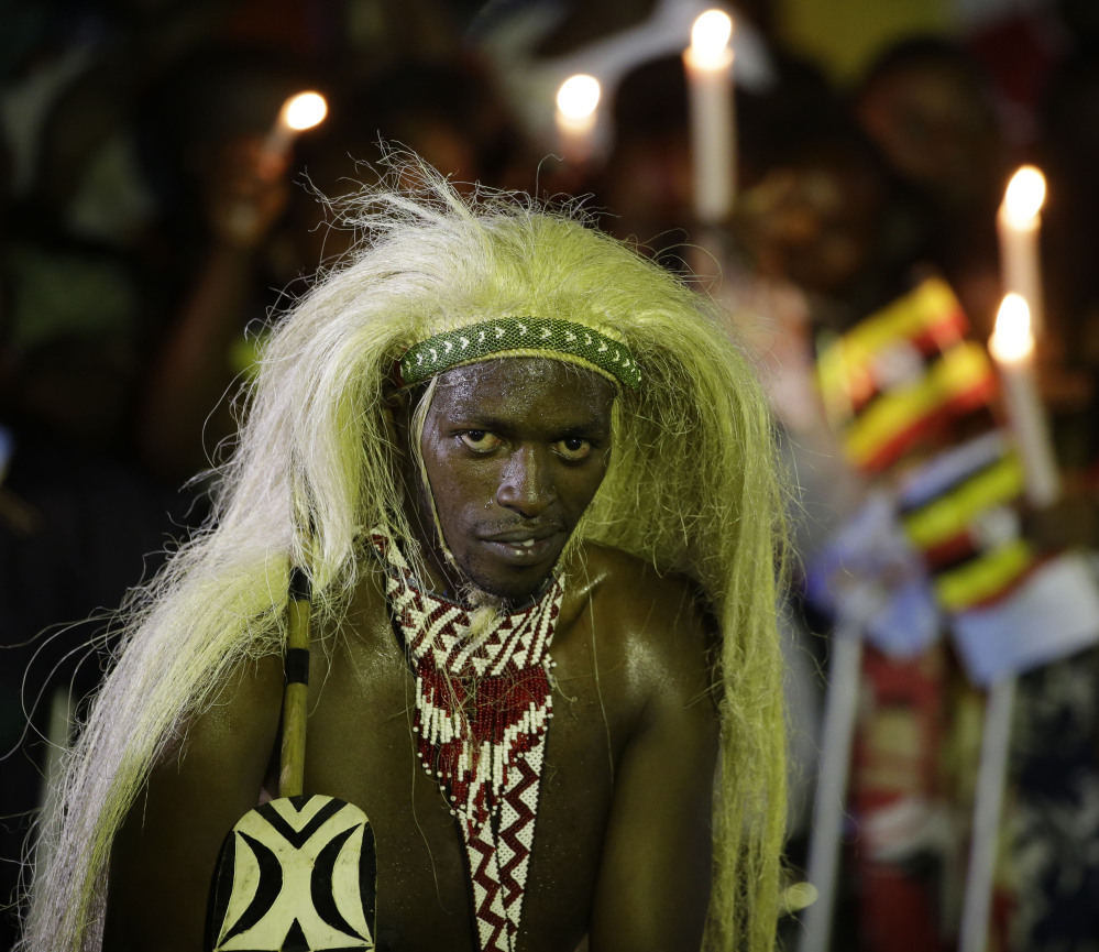 A man in traditional tribal clothing waits for the arrival of Pope Francis in Munyonyo, Uganda, on Friday. The Associated Press