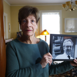 Claire Brannigan holds a photograph of her late husband, Joe Brannigan, a longtime Maine legislator who benefited from hospice care before he died in January.