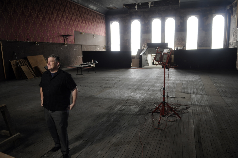 Mike Miclon stands on the third floor at the Johnson Hall Performing Arts Center, which is undergoing renovations, in May 2014.