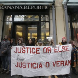 Protesters block an entrance to a Banana Republic store Friday in Chicago as hundreds hold a demonstration in response to the release of video showing an officer fatally shooting Laquan McDonald. The Associated Press