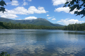 Mount Katahdin in Baxter State Park looms large and clear over Daicey Pond in July.