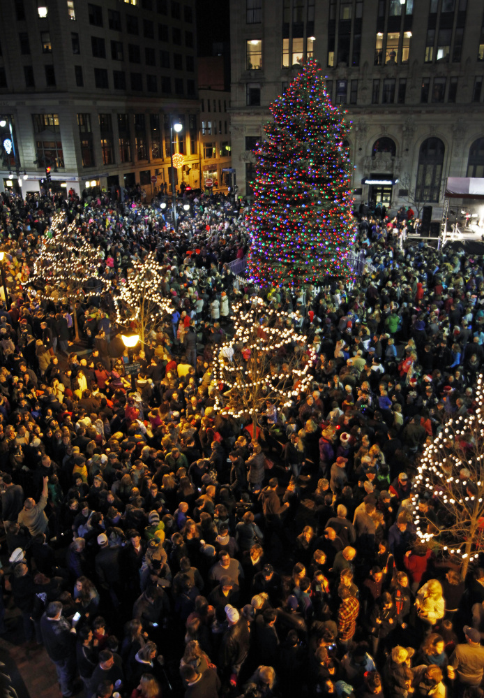 "Monument Square was jammed Friday evening for Portland's annual Christmas tree-lighting celebration, which included a visit from Santa Claus and Rick Charette singing holiday favorites. Temperatures in the 50s pushed turnout above the projected 3,000 people to an estimated 5,000, said city officials. ""It's nice that it's warm because last year it was freezing,"" said Jamie Edwards of Gorham, who attends each year with her young family."