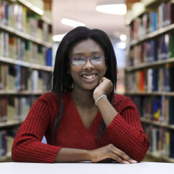 "At Olive-Harvey College library, 18-year-old Octavia Coaks says she feels lucky to be able to take advantage of the city's program for free community college. Addressing the costs of her education, Coaks said she doesn't ""want to put that kind of burden"" on her parents."