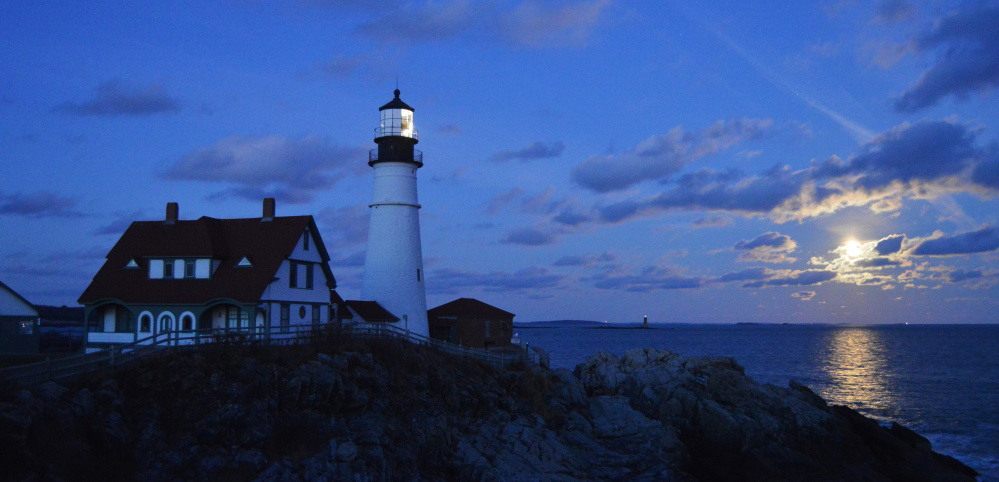 A full moon marks the dimming of another day, and that means the Rams Island Ledge and Portland Head lighthouses are shining while Brian Lovering of New Gloucester takes another fine photo of Maine's magic.