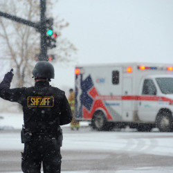 The Associated Press Police stand guard near a Planned Parenthood clinic Friday in Colorado Springs, Colorado.