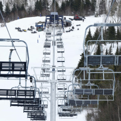 "Workers repair the King Pine chairlift at Sugarloaf in Carrabassett Valley in March, after an accident injured seven skiers. ""We're making these lifts as safe as possible with the most modern standards and components,"" said Rich ""Crusher"" Wilkinson, vice president of mountain operations."