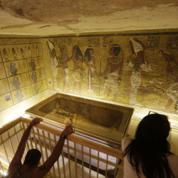 King Tut's tomb is displayed in a glass case at the Valley of the Kings in Luxor, Egypt. Egyptian Antiquities Minister Mamdouh el-Damaty said there is a 90 percent chance that hidden chambers will be found in the 3,300-year-old mausoleum.