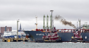 "Tugboats guide the Cypriot tanker Sparto as it delivers more than 779,000 barrels of crude oil Saturday to Portland Pipe Line in South Portland, a scene that plays out only a couple of times a month now, officials say. ""It's a ghost town,"" said Brian Fournier, president of Portland Tugboat."