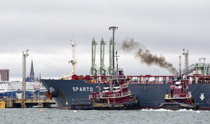 """Tugboats guide the Cypriot tanker Sparto as it delivers more than 779,000 barrels of crude oil Saturday to Portland Pipe Line in South Portland, a scene that plays out only a couple of times a month now, officials say. """"It's a ghost town,"""" said Brian Fournier, president of Portland Tugboat."""
