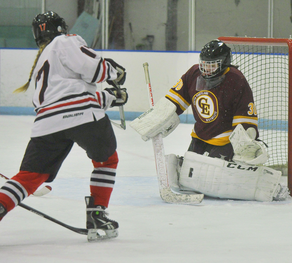 Cape Elizabeth goalie Abby Joy, who stopped 20 shots, makes a pad save on a scoring bid by Taylor Veilleux of Scarborough.