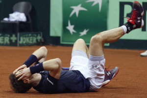 Britain's Andy Murray celebrates winning the Davis Cup after defeating Belgium's David Goffin in three sets, 6-3, 7-5, 6-3, during their singles Davis Cup Sunday in Ghent, Belgium