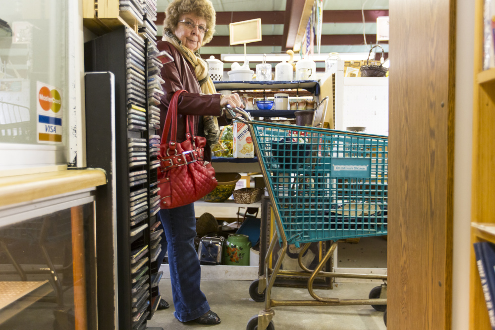 """Joan Moryl, of Westminster, Mass., strolls the aisles at Bo-Mar Hall. Another Bay State resident, Steve Louf, said he is upset that the store he has frequented for seven years is closing. """"The people who work here are the best of the best,"""" he said."""