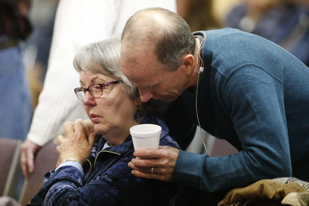 Scott Dontanville, co-pastor of the Hope Chapel, consoles a congregant before service early Sunday in northeast Colorado Springs, Colo. University of Colorado-Colorado Springs police officer Garrett Swasey, who was one of the three victims of a shooting at a nearby Planned Parenthood clinic Friday, was a member of the congregation.