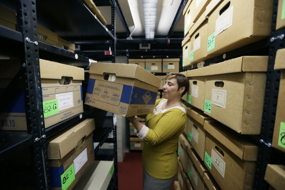 In an Oct. 22 photo in Ann Arbor, Mich., Olga Virakhovskaya, the lead archivist for collections management at Bentley Historial Museum, University of Michigan, moves a box containing files on assisted suicide that belonged to Dr. Jack Kevorkian.