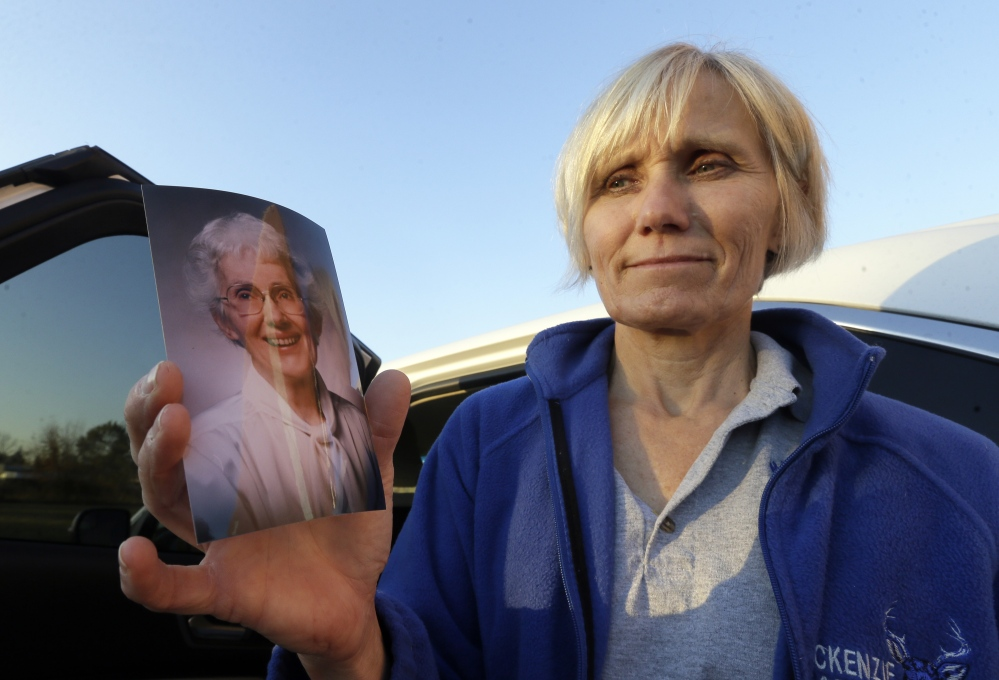 In a photo from Monday, Nov. 9, 2015, in Detroit, Carol Poenisch holds a photo of her mother, Merian Frederick, who died with Dr. Jack Kevorkian's assistance.