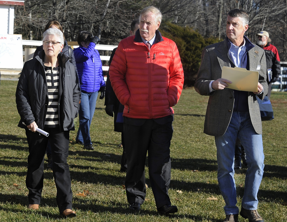 The head of the U.S. Environmental Protection Agency, Gina McCarthy, left, visits Smiling Hill Farm to talk with farmers and U.S. Sen. Angus King about new water quality rules. McCarthy and King were given a tour of the farm by Warren Knight, right, who owns the farm with his family.