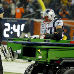 New England Patriots tight end Rob Gronkowski (87) is carted off the field after being injured against the Denver Broncos during the second half of an NFL football game, Sunday, Nov. 29, 2015, in Denver. (AP Photo/Jack Dempsey)