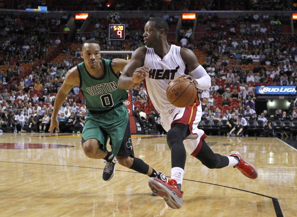 Miami Heat guard Dwyane Wade drives past Celtics guard Avery Bradley in the first quarter of the Celtics' win Monday night in Miami.
