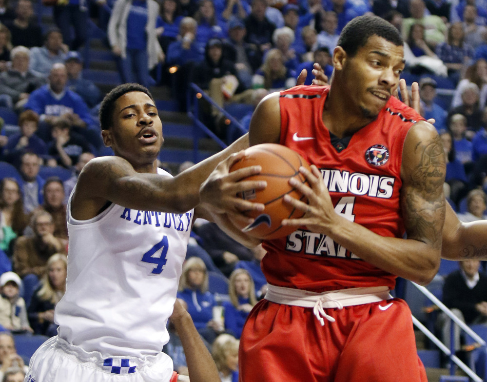 Illinois State's DeVaughn Akoon-Purcell, right, pulls down a rebound next to Kentucky's Charles Matthews (4) during the first half of an NCAA college basketball game Monday, Nov. 30, 2015, in Lexington, Ky. (AP Photo/James Crisp)