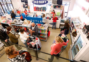 Customers wait in line to check out after shopping at Old Navy in Kittery.