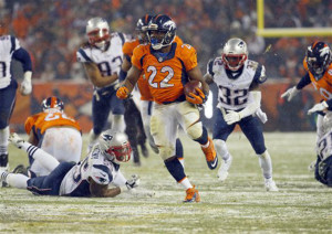 Denver Broncos running back C.J. Anderson breaks free for the game-winning touchdown against the New England Patriots in overtime Sunday in Denver. The Broncos defeated the Patriots 30-24. The Associated Press