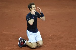 Britain's Andy Murray celebrates winning the Davis Cup after defeating Belgium''s David Goffin in three sets, 6-3, 7-5, 6-3,  Sunday. The Associated Press