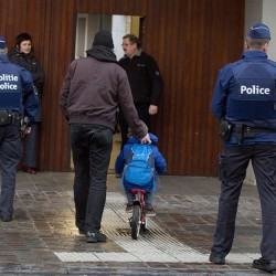 Students in Brussels have begun returning to class after a two-day shutdown over fears that a series of terrorist attacks.